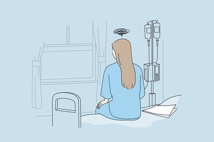 woman sitting on hospital bed thinking