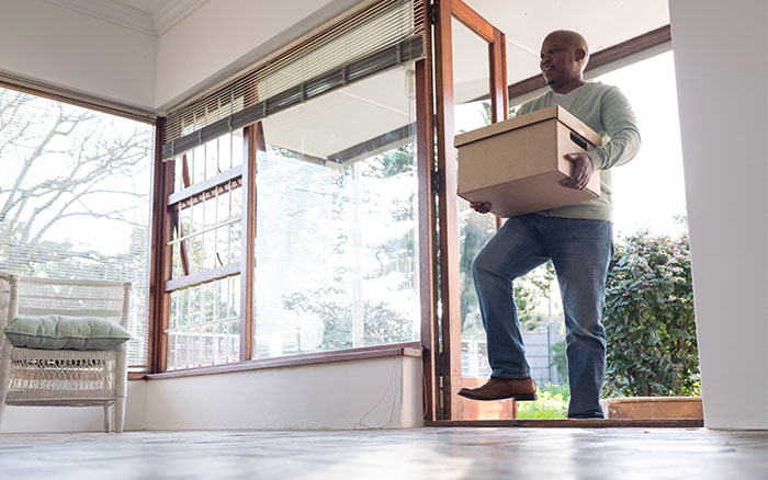 Man Moving into housing